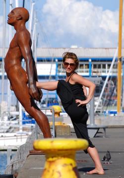 Lauren plays with the Bronze Man