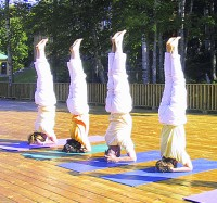 Headstand in group, a part of ashram life
