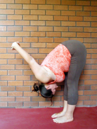 Jessica demonstrating Uttanasana