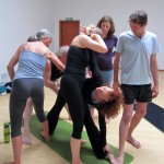 Assisting trikonasana
