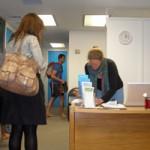 Jennifer Parker greets students at her yoga studio