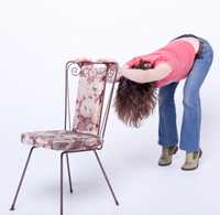 Chairs make great props for bending forward