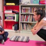 Maya teaching at her Community Yoga Project
