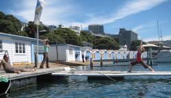 Kelly practicing asana on the dock