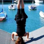 Lauren demonstrates headstand on a blue sky Wellington day
