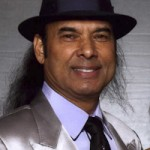 Bikram in a shiny suit