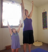 Sara in her yoga room