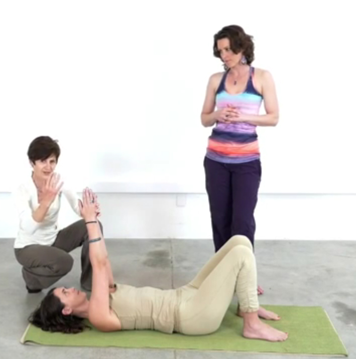 Christine Cutbush demonstrating a Feldenkrais technique for freeing up twists in your yoga practice