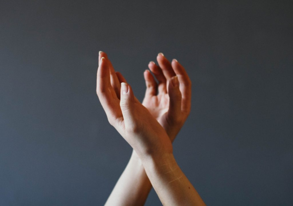 Hands gentle yoga trauma